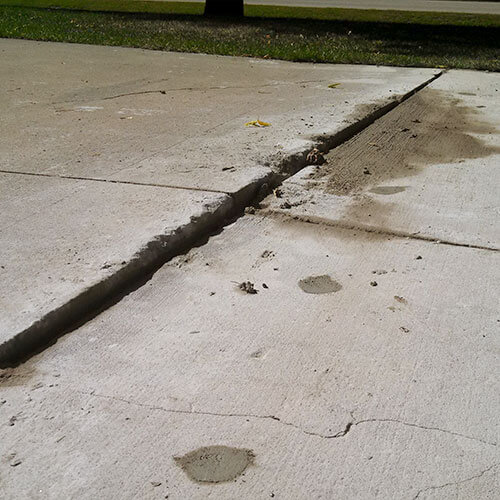 Cracked uneven driveway