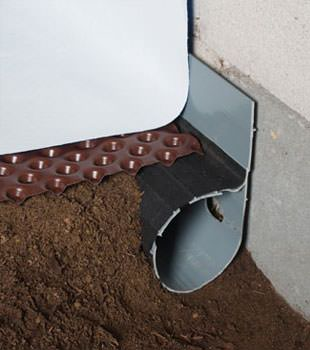 Closeup of a crawl space drainage system installed in Champlin