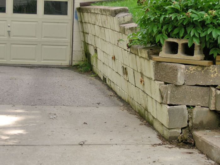 a failing retaining wall around a driveway in Fargo