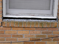 A window sill cracking and separating from the foundation wall in a Eden Prairie home.