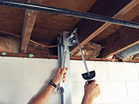 Straightening a foundation wall with the PowerBrace™ i-beam system in a Eden Prairie home.