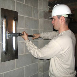 installing a wall anchor to repair an bowing foundation wall in Maple Grove