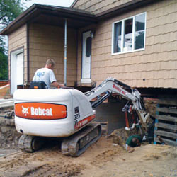 Excavating to expose the foundation walls and footings for a replacement job in La Crosse