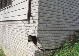 A severely damaged foundation wall in Cottage Grove