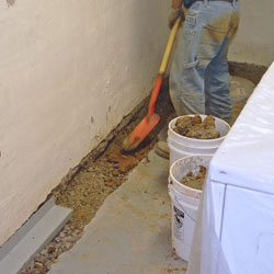 Digging a trench for a French Drain system in Rochester