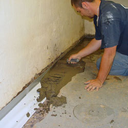 Testing a French drain system in a Burnsville home.