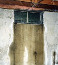 Flooding through basement windows in a Welch home.