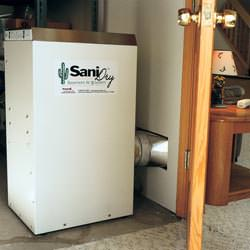 A basement dehumidifier with an ENERGY STAR® rating ducting dry air into a finished area of the basement  in Austin