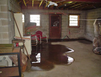 a flooded basement floor in a Austin home