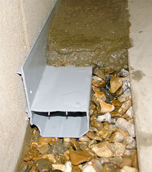 A basement drain system installed in a Zumbrota home