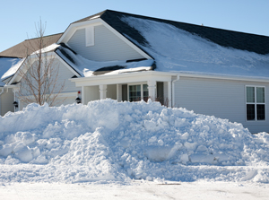 Huge snow pile outside of home