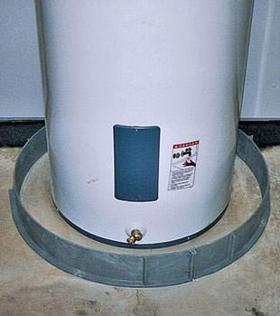 An old water heater in Winona, MN, ND, IA, and WI with flood protection installed